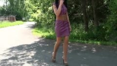 Cheap Street Slut Smokes And Struts In High Heels And Short Skirt